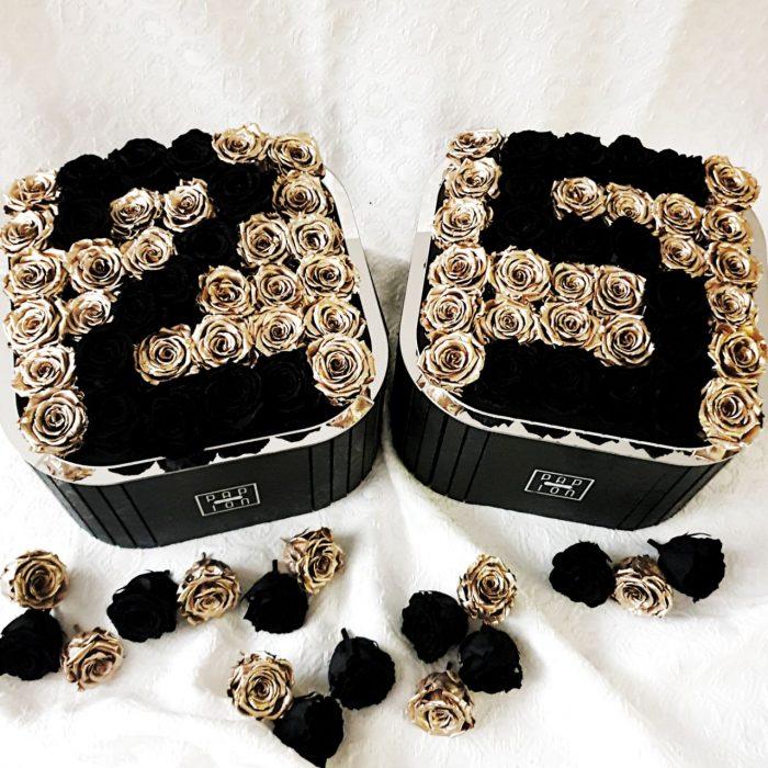 numero 25 con rose stabilizzate nere e dorate
