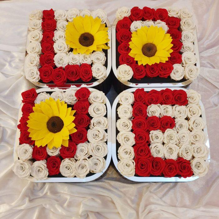 LOVE con girasoli e rose fiori stabilizzati